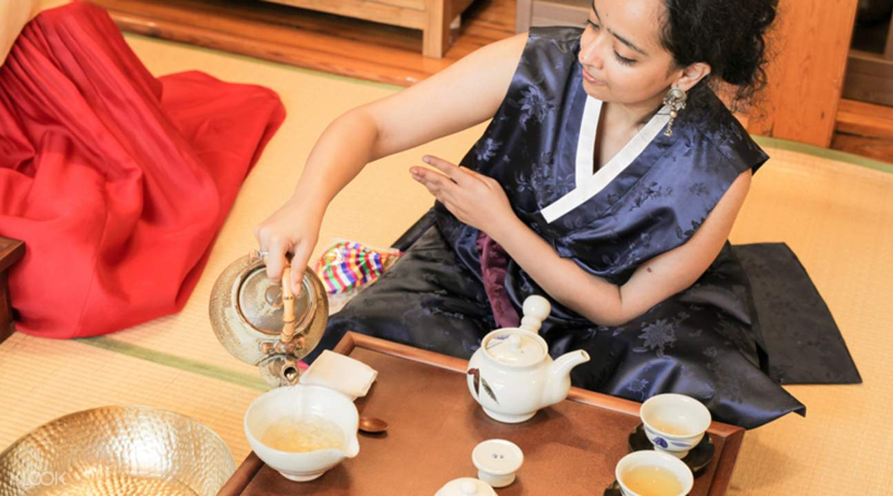 woman pouring tea during traditional korean tea experience