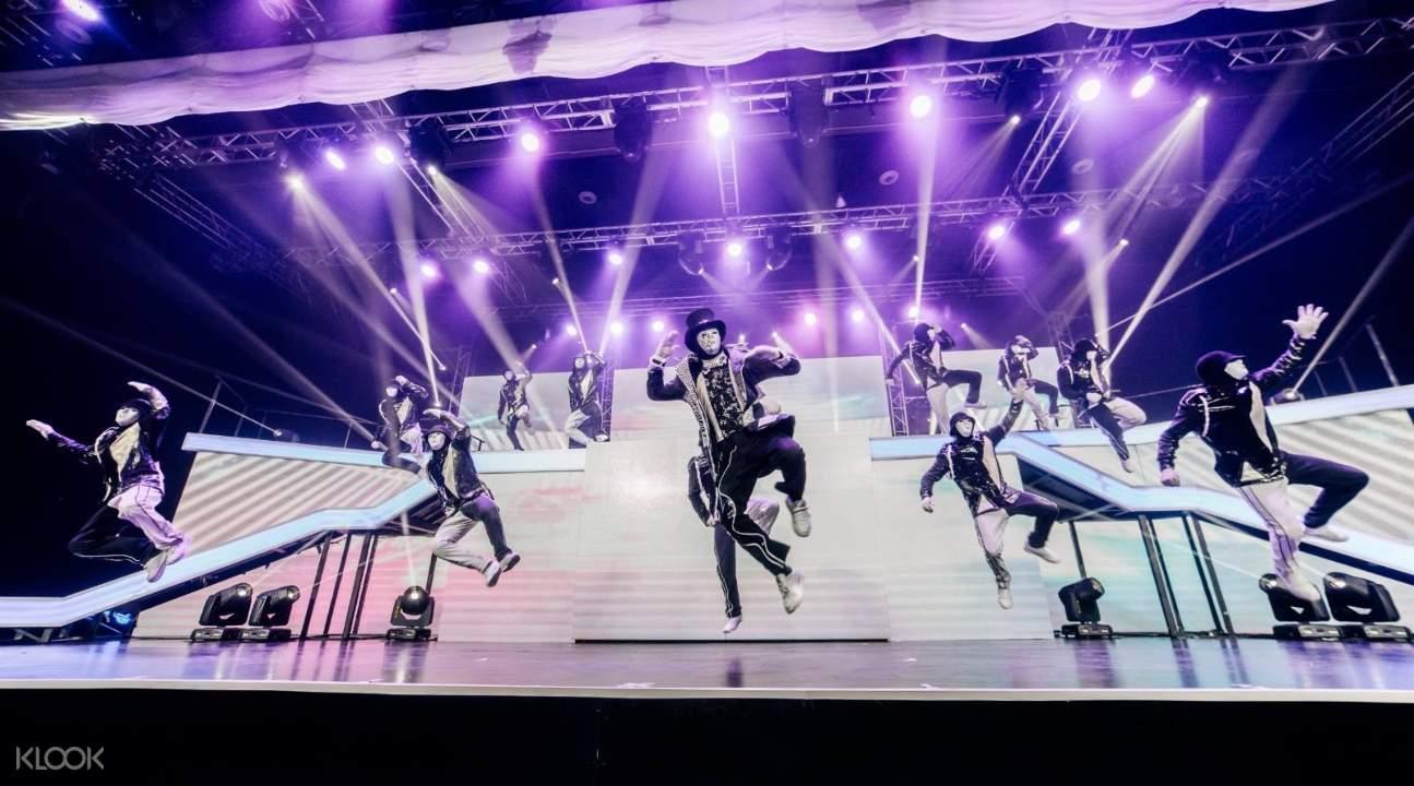 a Jabbawockeez dance performance with purple lights