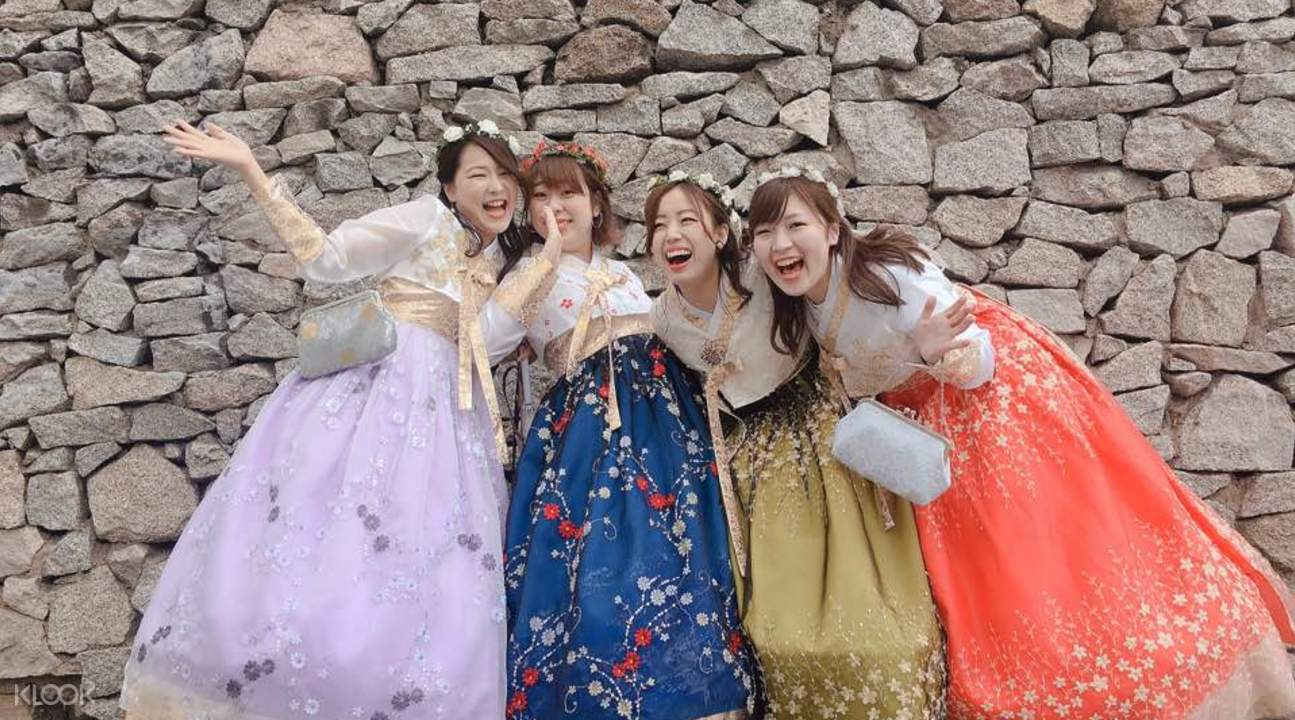 friends wearing hanboks posing for picture