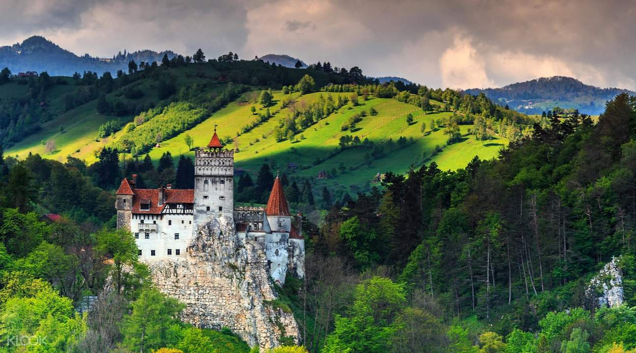 bran castle with mountains, aerial view