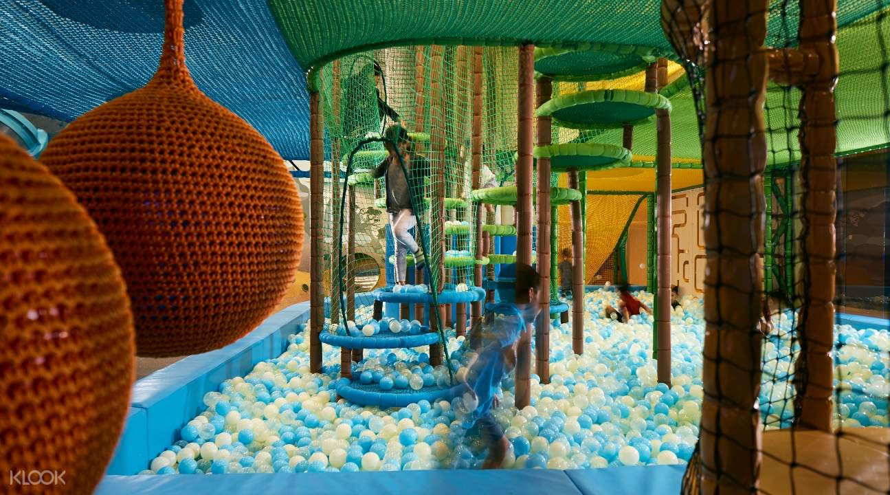 a kid in an indoor jungle gym