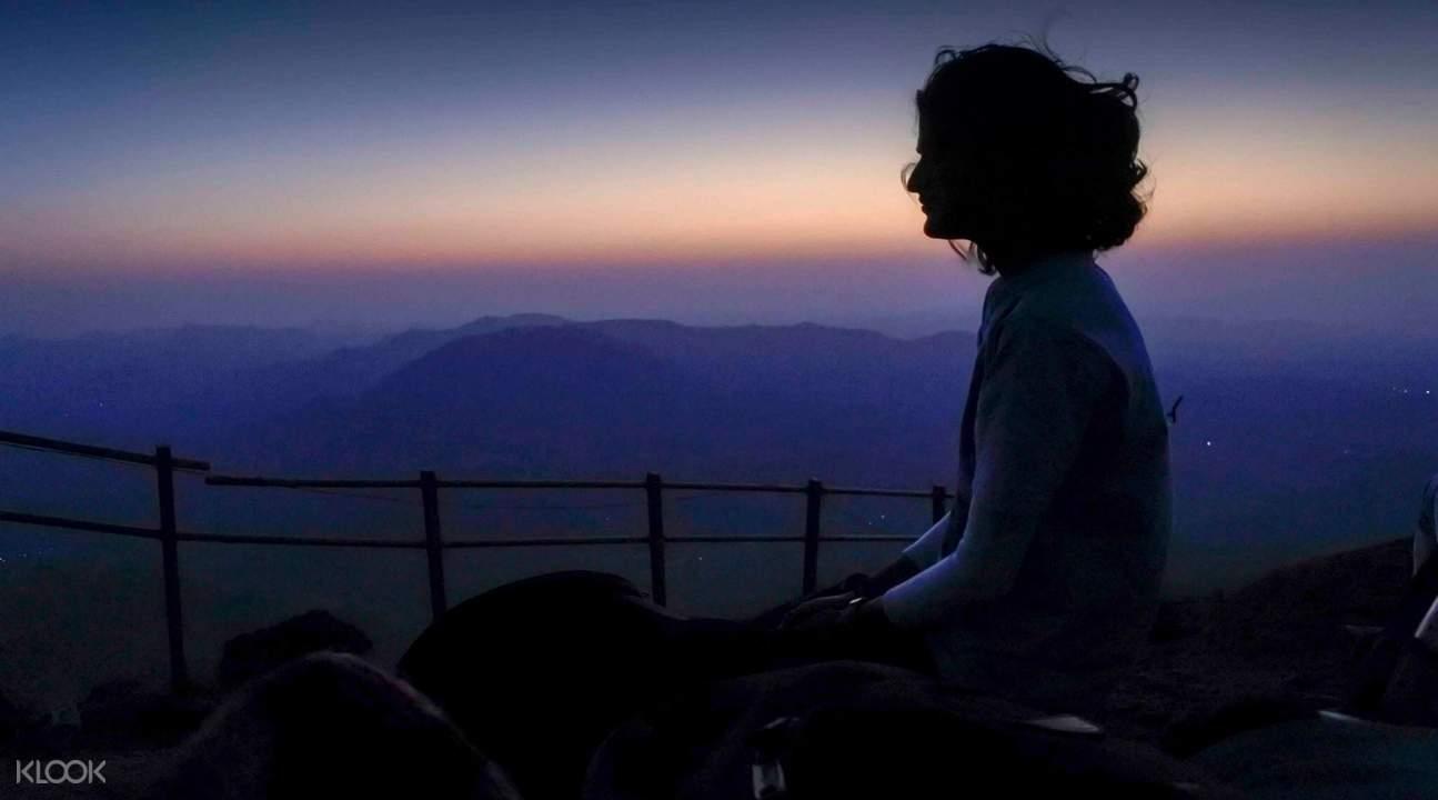 trekker at kalsubai mountaintop, dawn