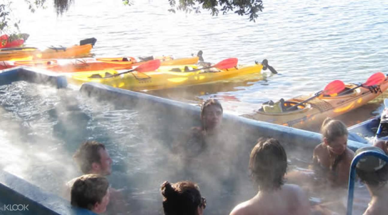 people bathing in Manupirua Hot Pools