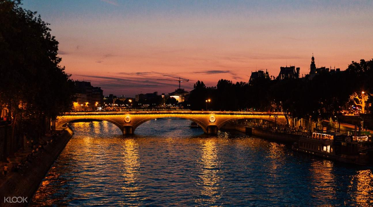 a view of the Seine River and a bridge
