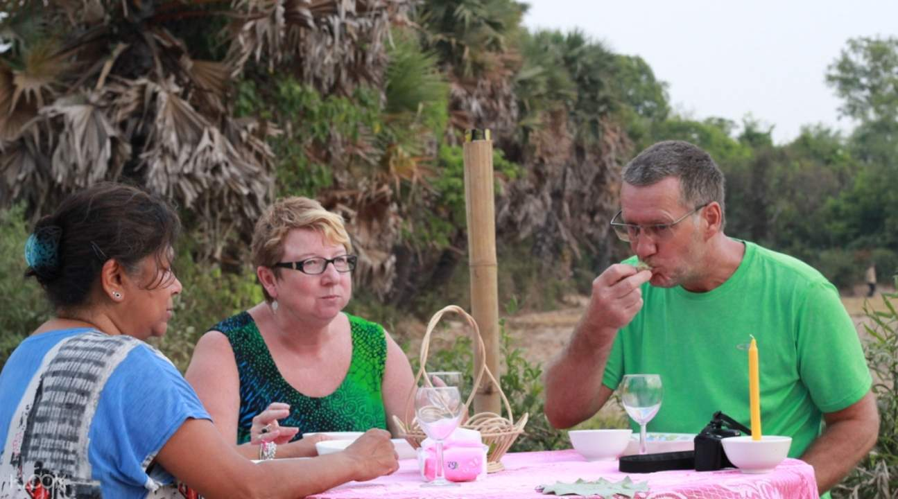 Tourist eat Khmer dish outdoors