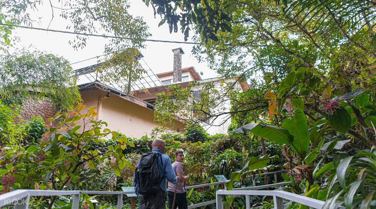 people standing in front of house in Kinabalu Park Sabah