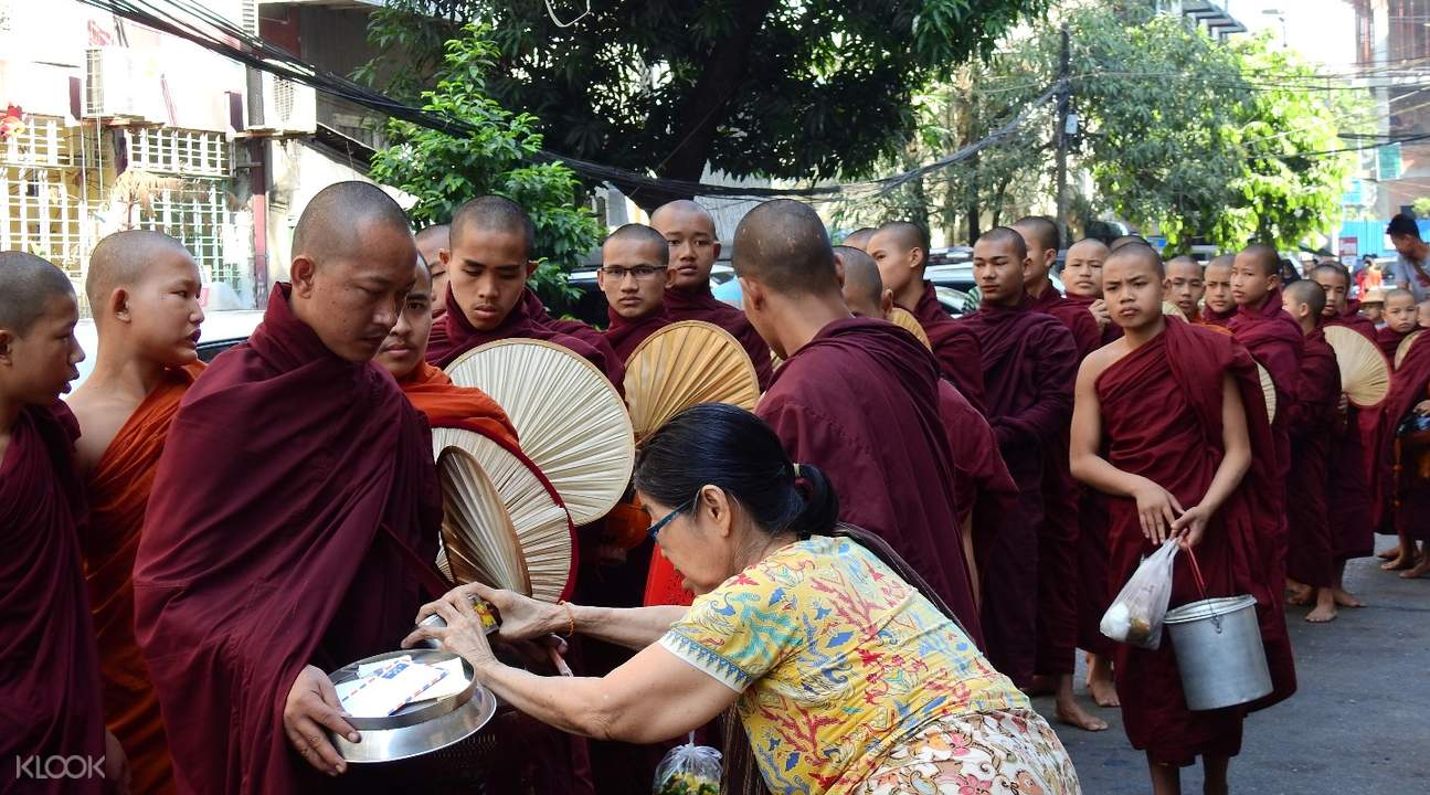 alms giving ceremony amarapura