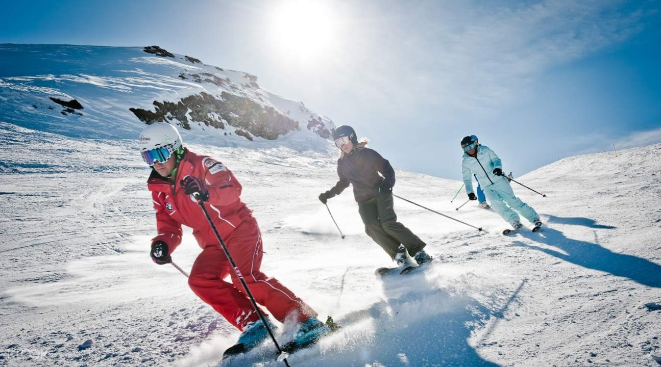 people skiing down a slope