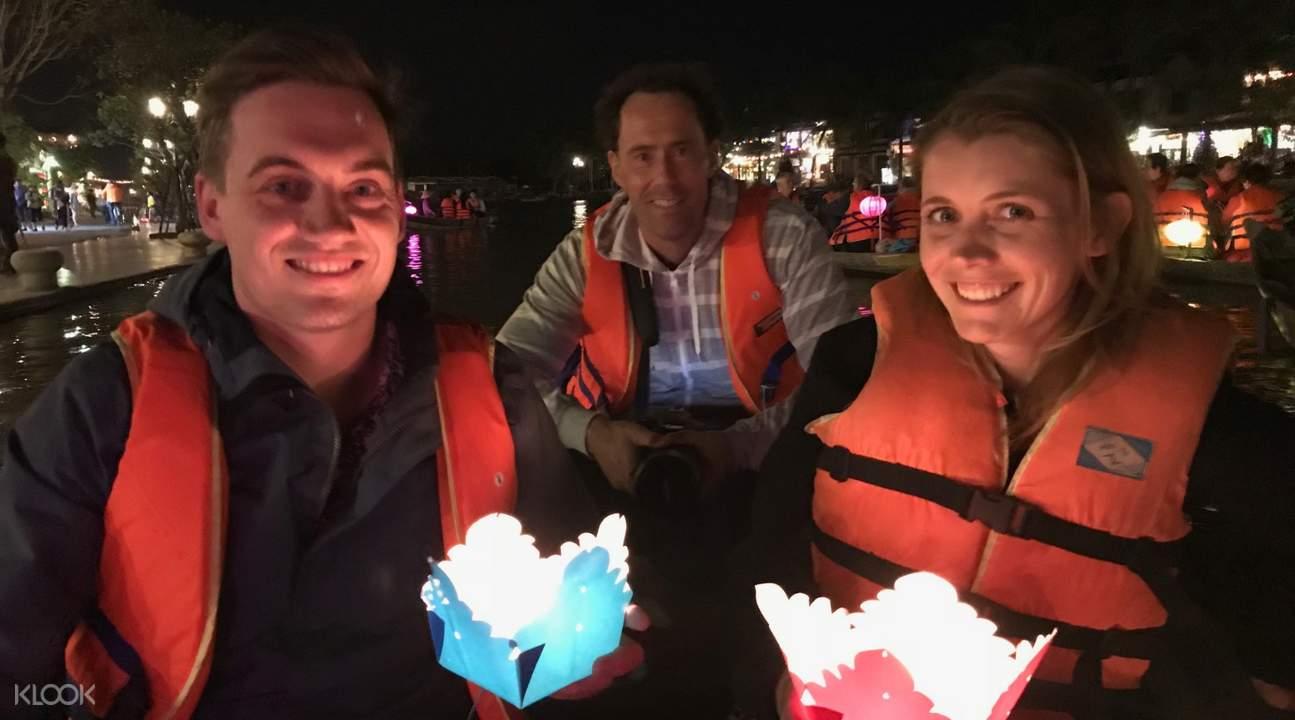 tourists holding lanterns