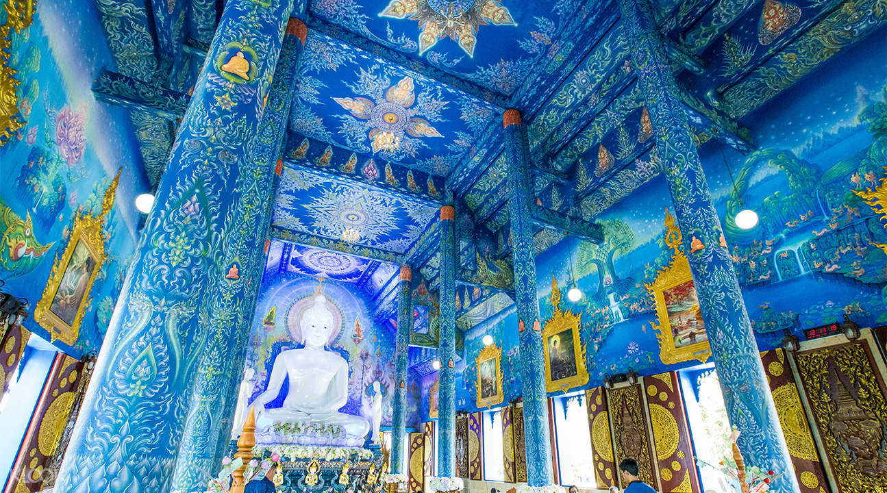 interior of blue temple with buddha