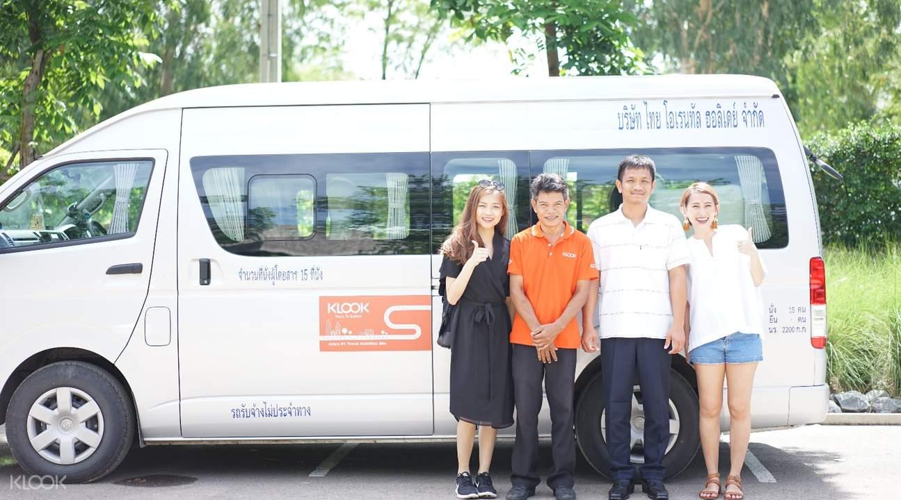 tourists standing in front of van