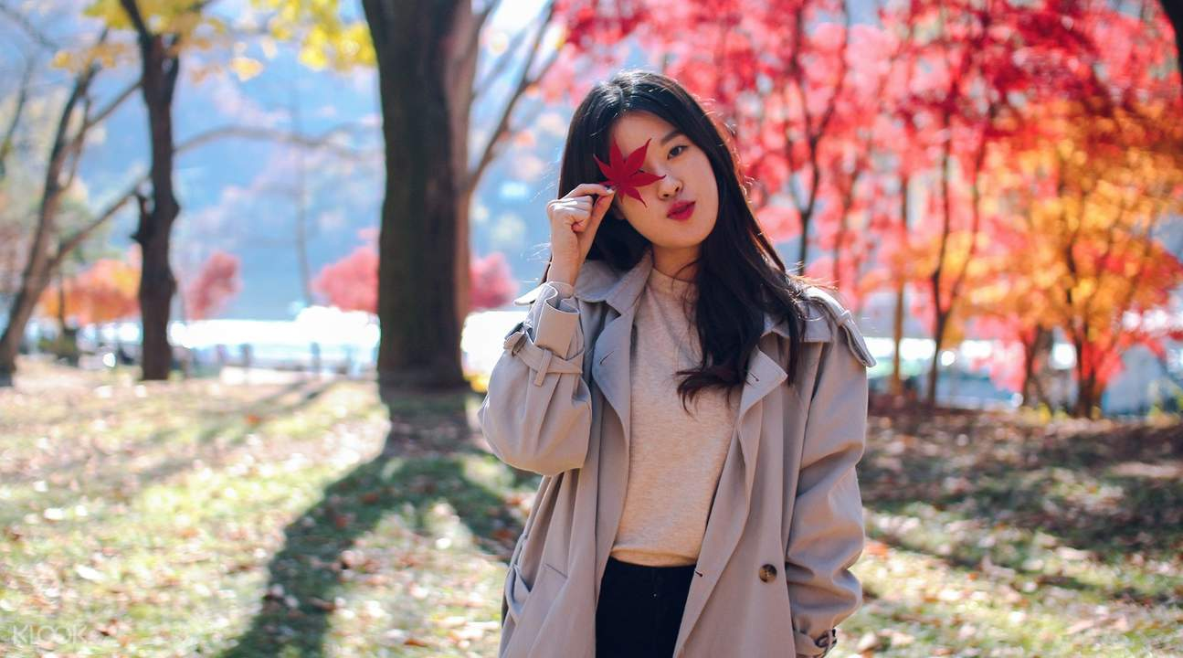 girl posting in front of the camera in nami island autumn season