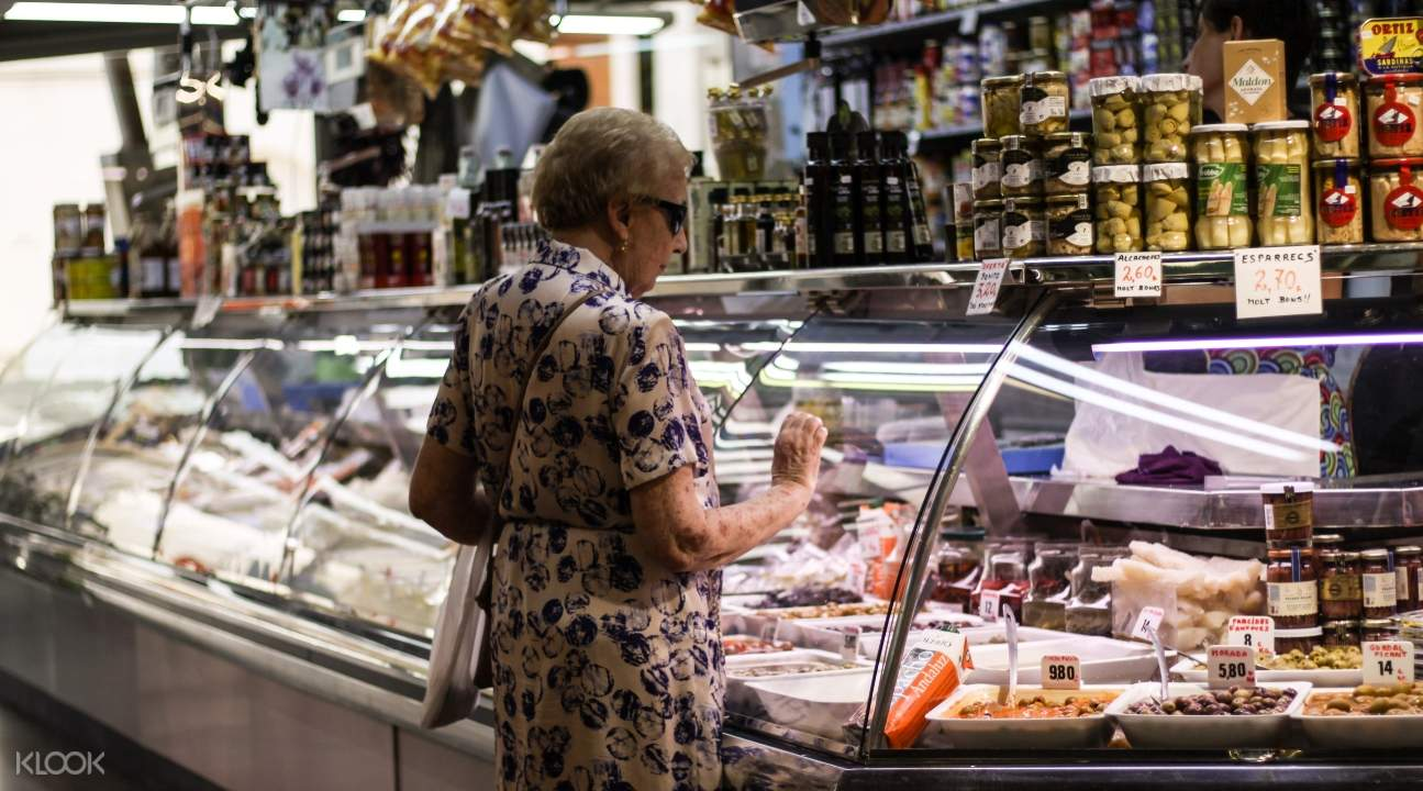 an old lady browsing for something to buy in a grocery