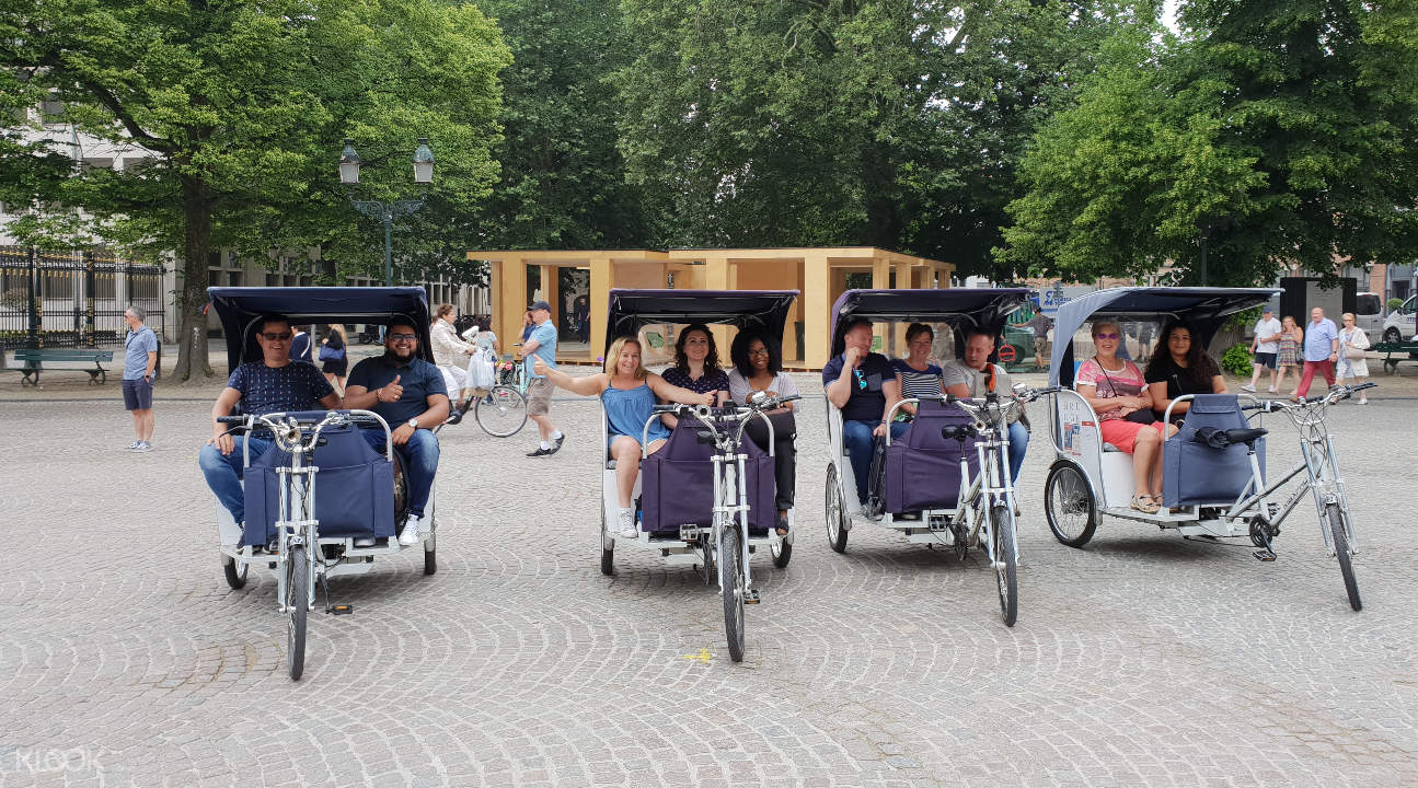 four rickshaws touring Bruges