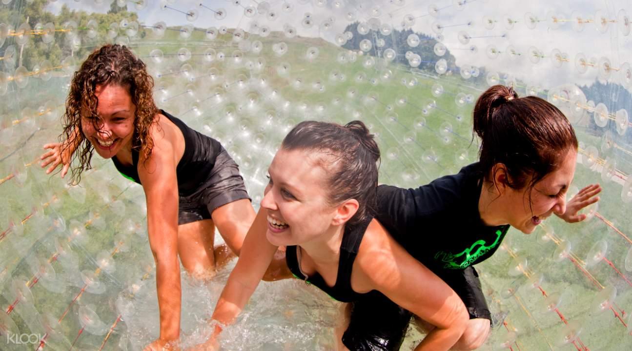 3 women inside H2OGO inflatable ball