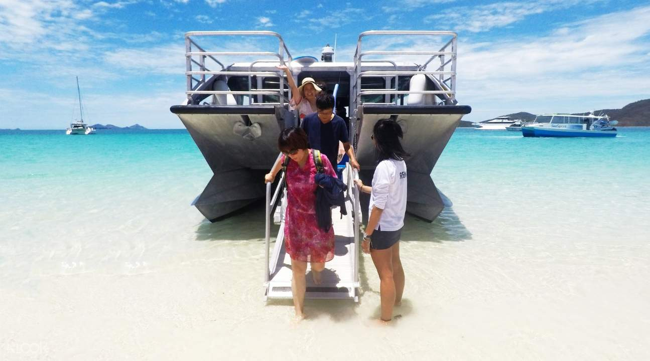 guests sightseeing on whitehaven beach hill inlet lookout