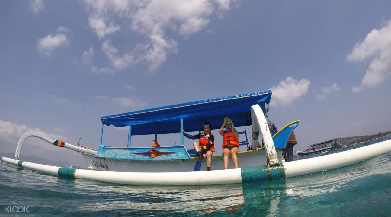 People riding a boat in Gili Islands