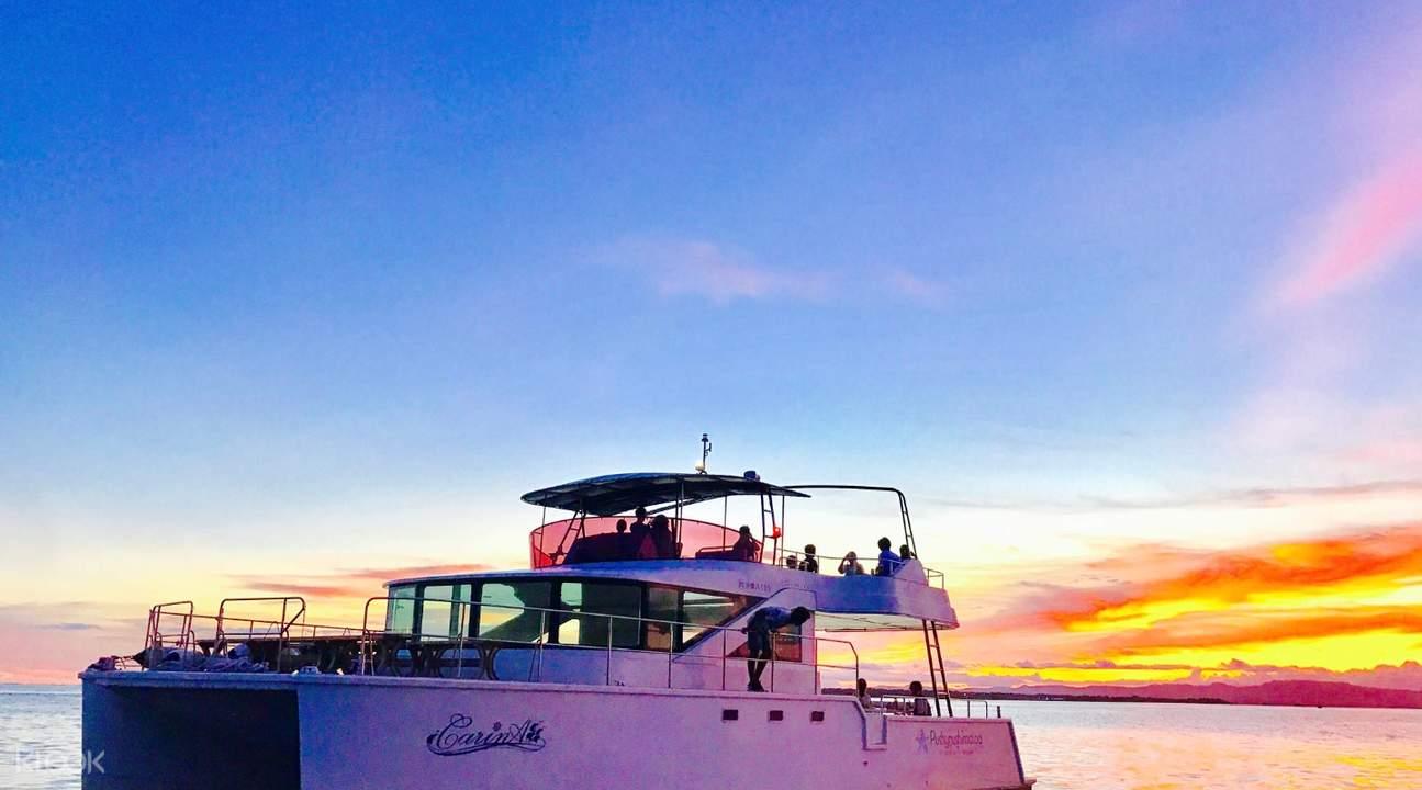 boat sailing by ishigaki island during sunset