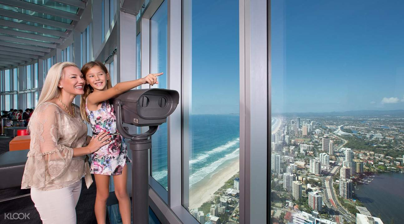 woman and child enjoying view from gold coast observation deck with binoculars