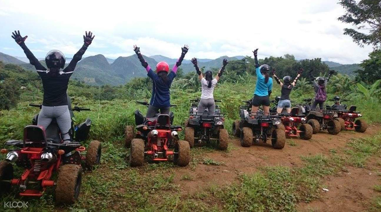 tourists raise their arms in rizal
