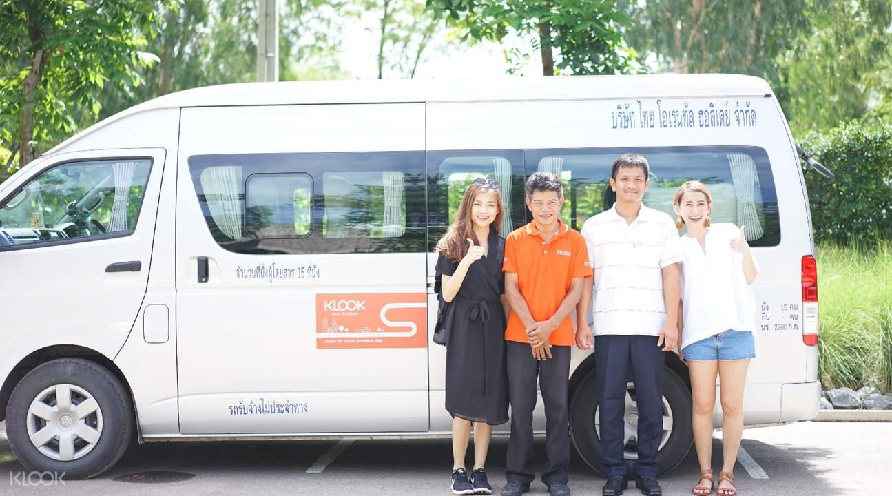 tourists standing in front of van charter