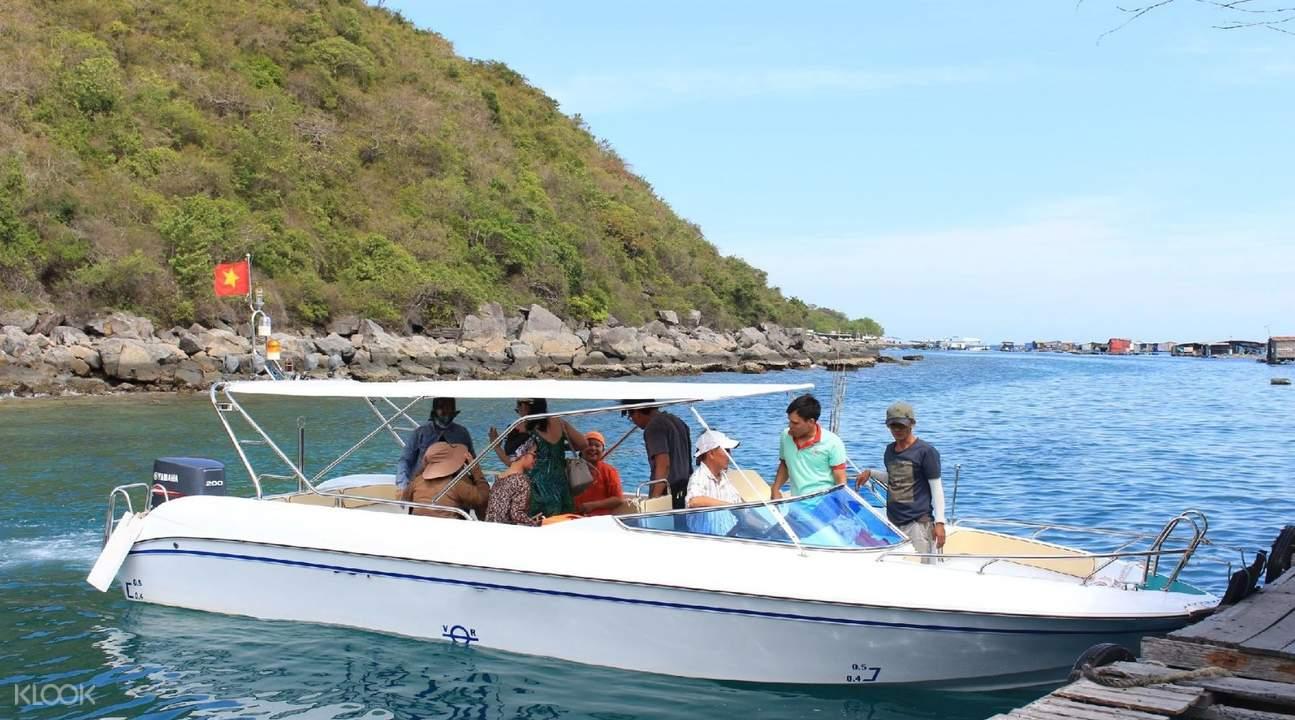 people riding speedboats at nha trang bay