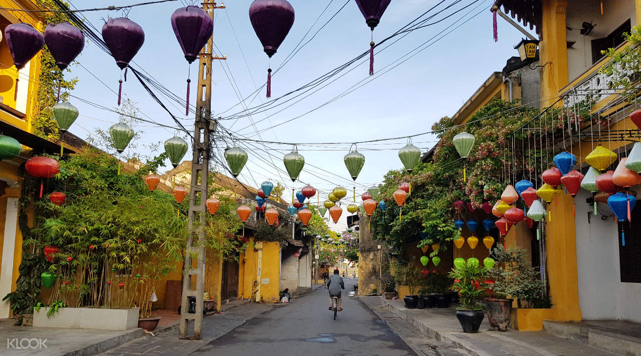 a street in Hoi An with decorations hanging between houses