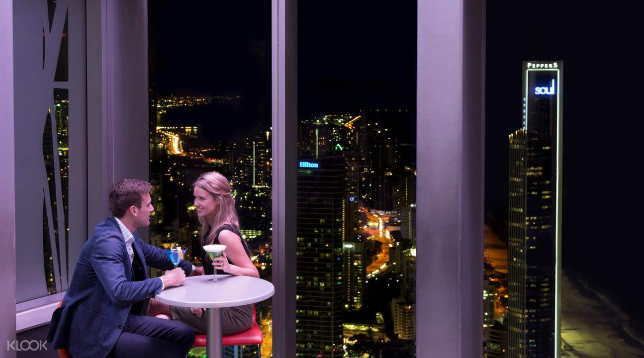 man and woman enjoying drinks at gold coast observation deck bar