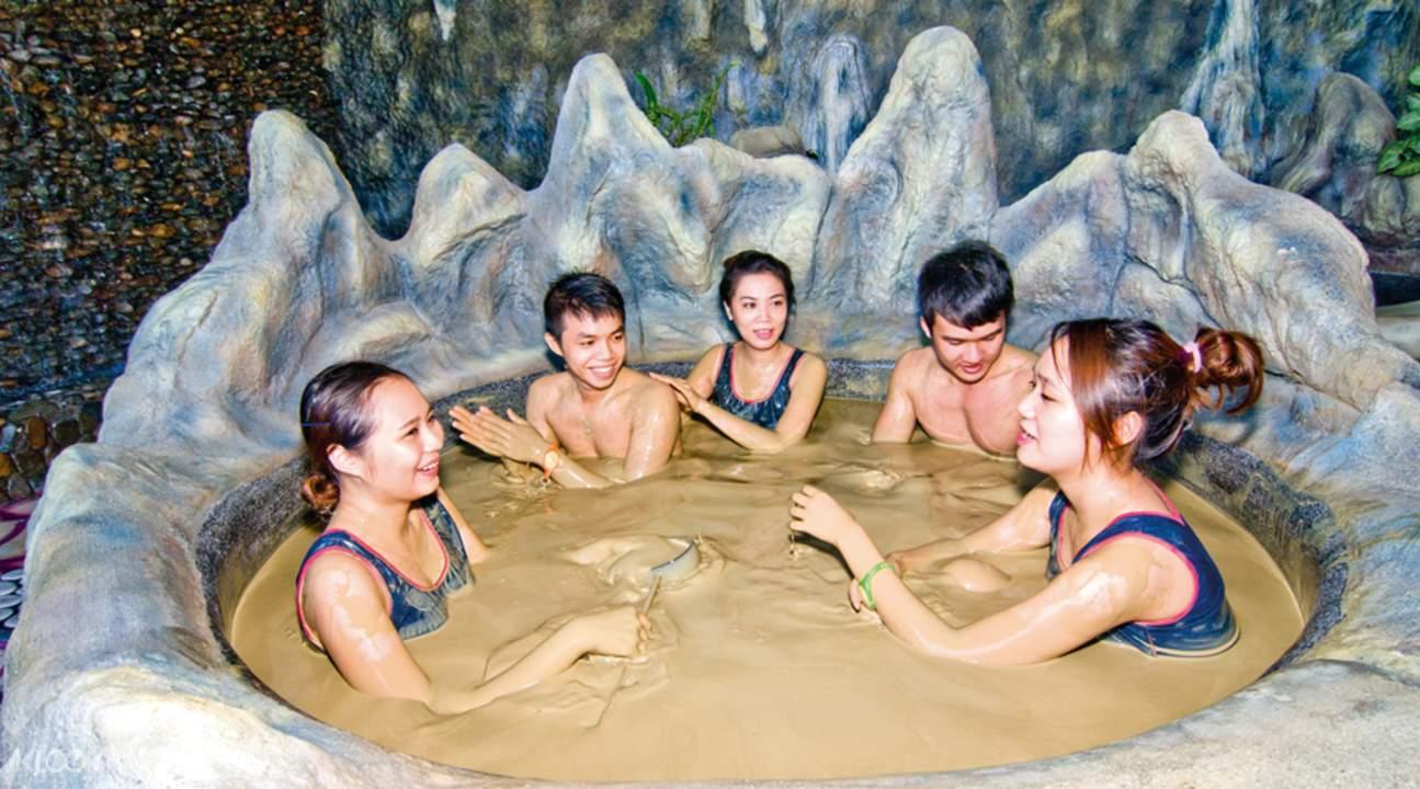 friends taking a mud bath