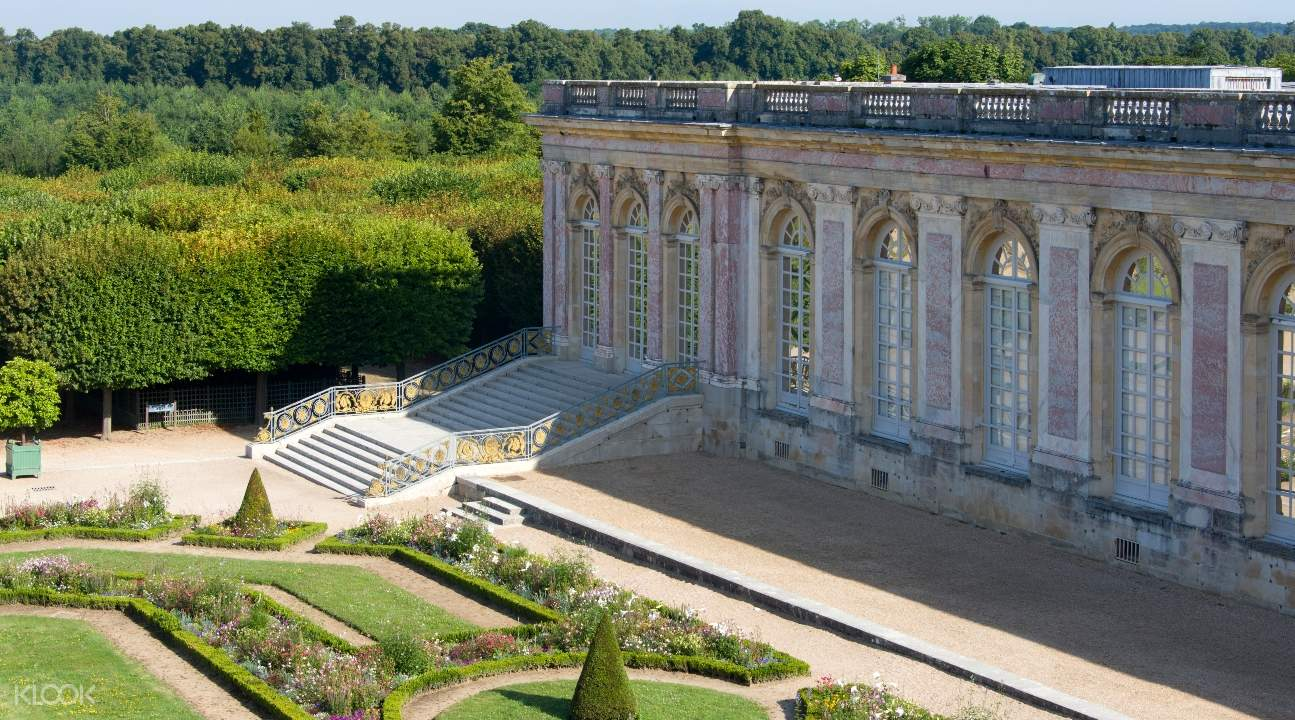 a view of the exteriors of Versailles from its garden area