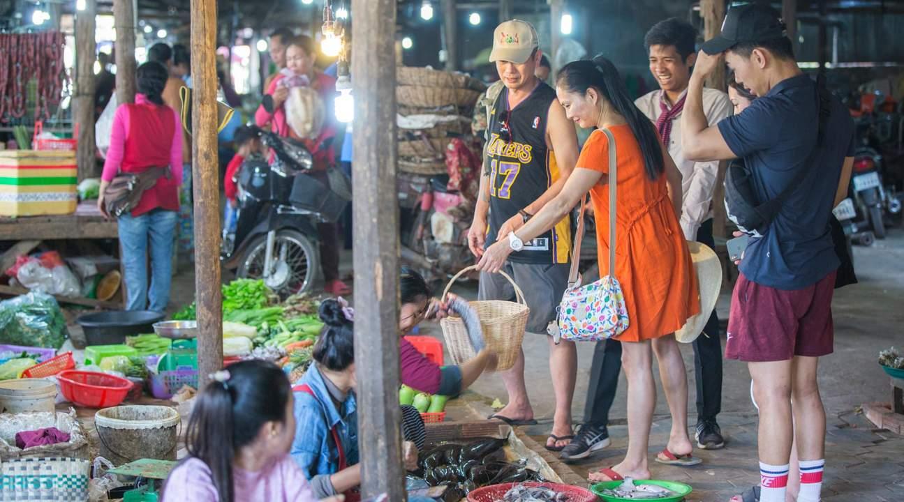 fish vendors inside a local market in siem reap