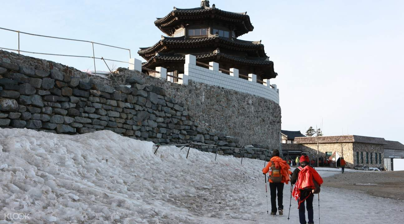 people walking next to temple in mount Deogyusan