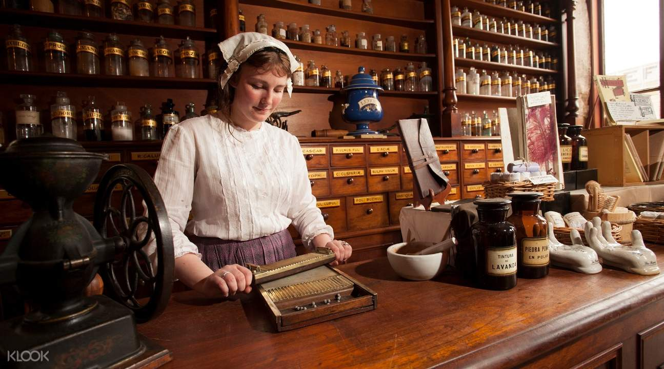 woman in costume behind cash register in sovereign hill australia