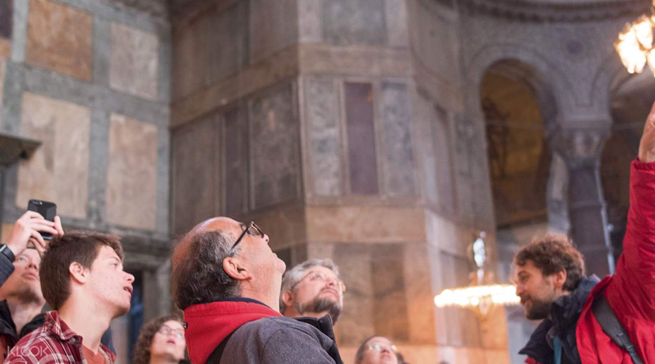people inside Hagia Sophia Museum with guide