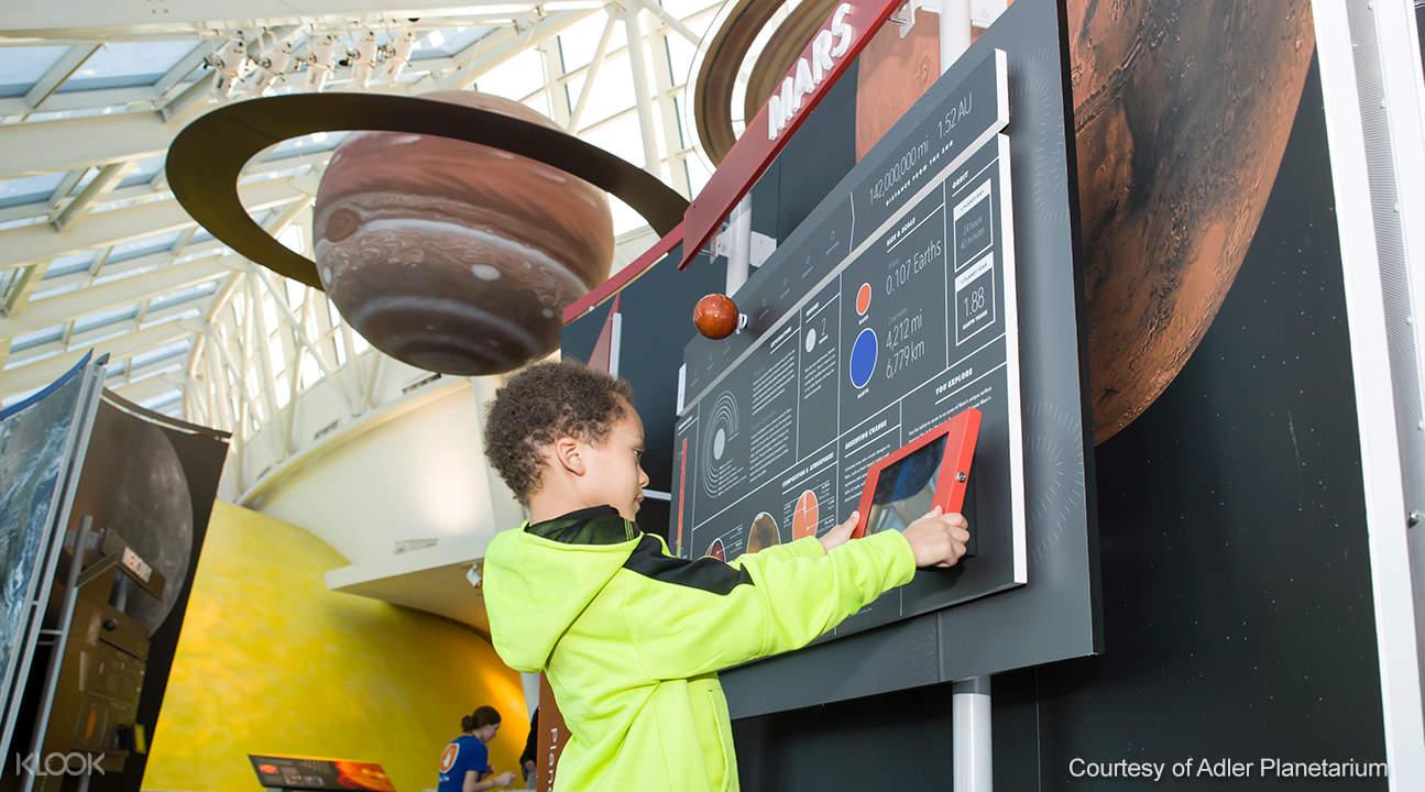 a kid inside the Adler Planetarium