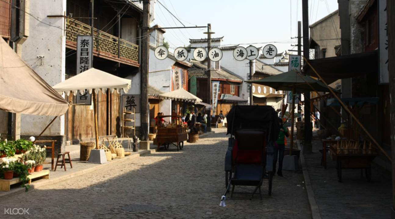 an old street inside the base with a parker rickshaw to the right