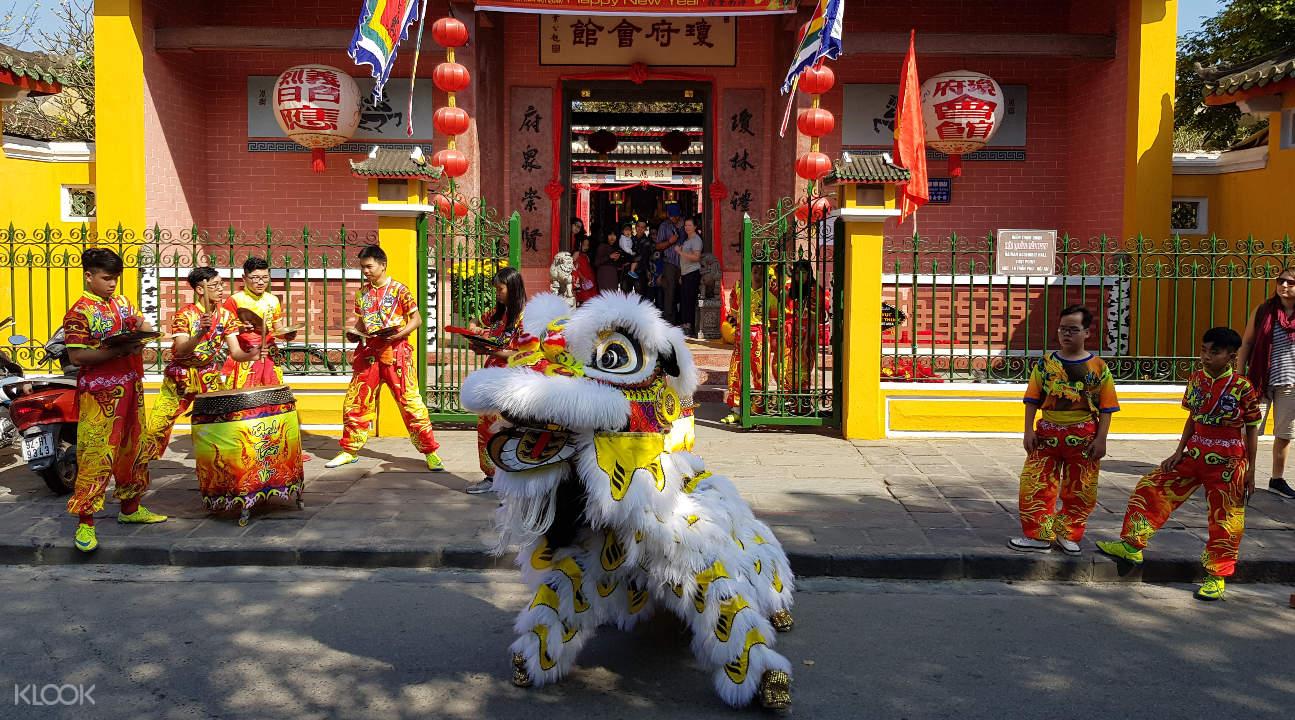 a dragon dance street performance in Hoi An
