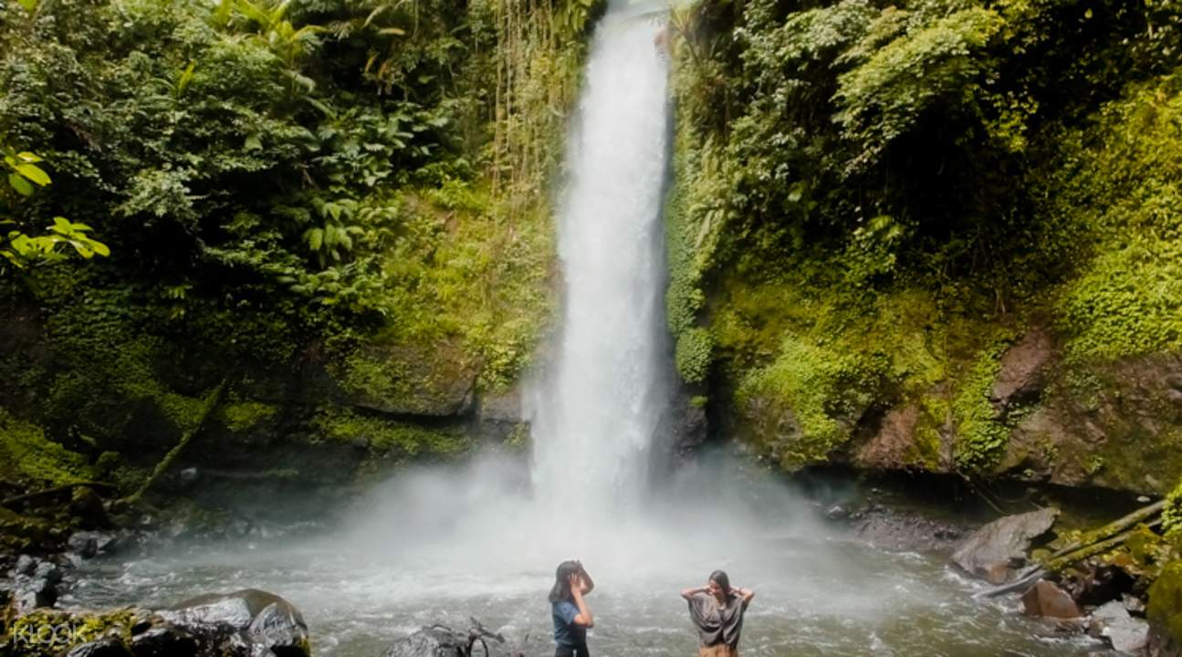 girls swimming in Curug Sawer Waterfall