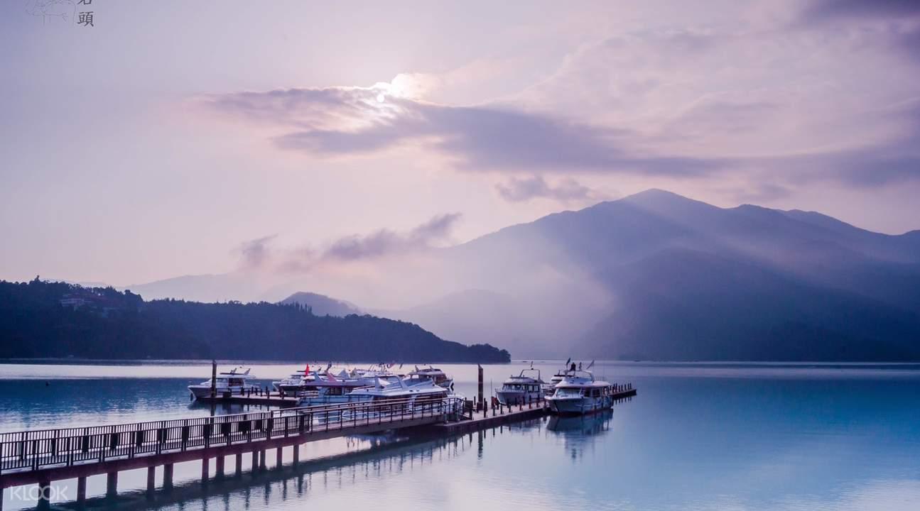 sun moon lake with boats