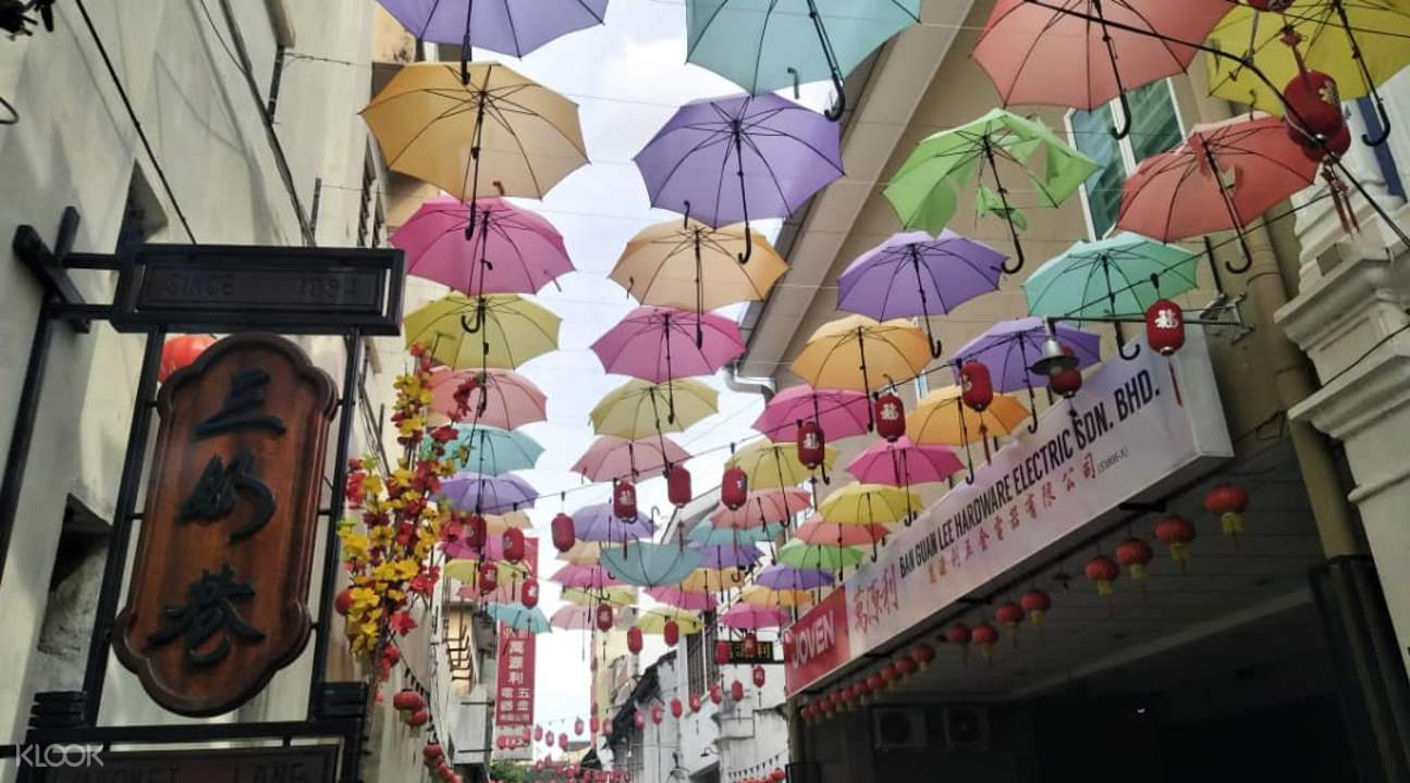 Colorful umbrellas hanging above a street in Ipoh
