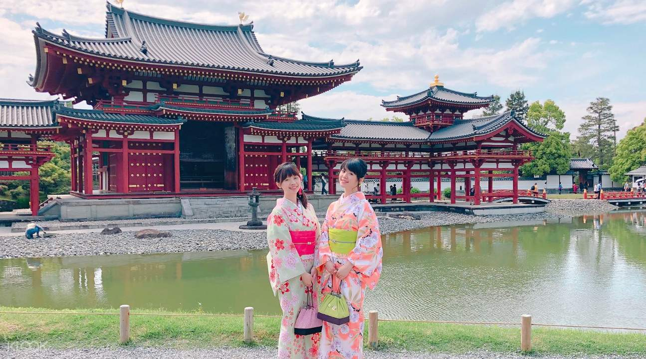 girls wearing kimono posing near temple