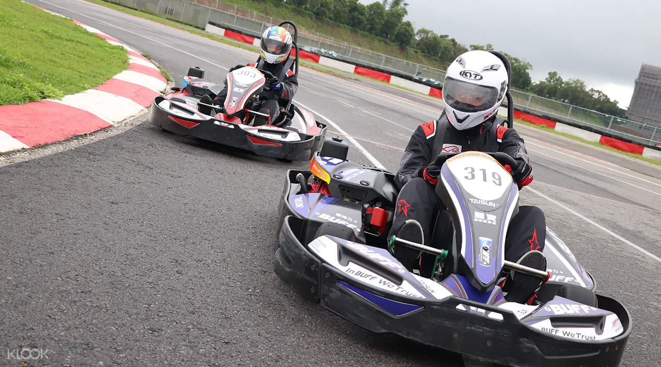 two people racing in kart racing Lihpao Racing park