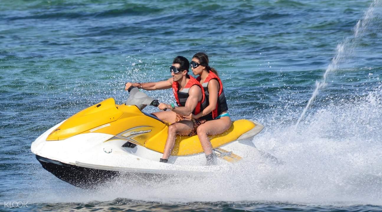 couple jet skiing in nusa dua bali