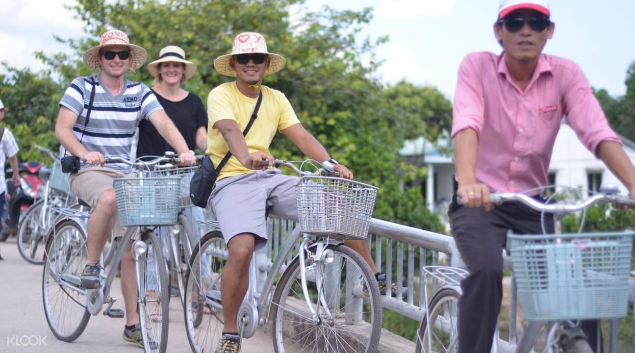 tourists biking along the road
