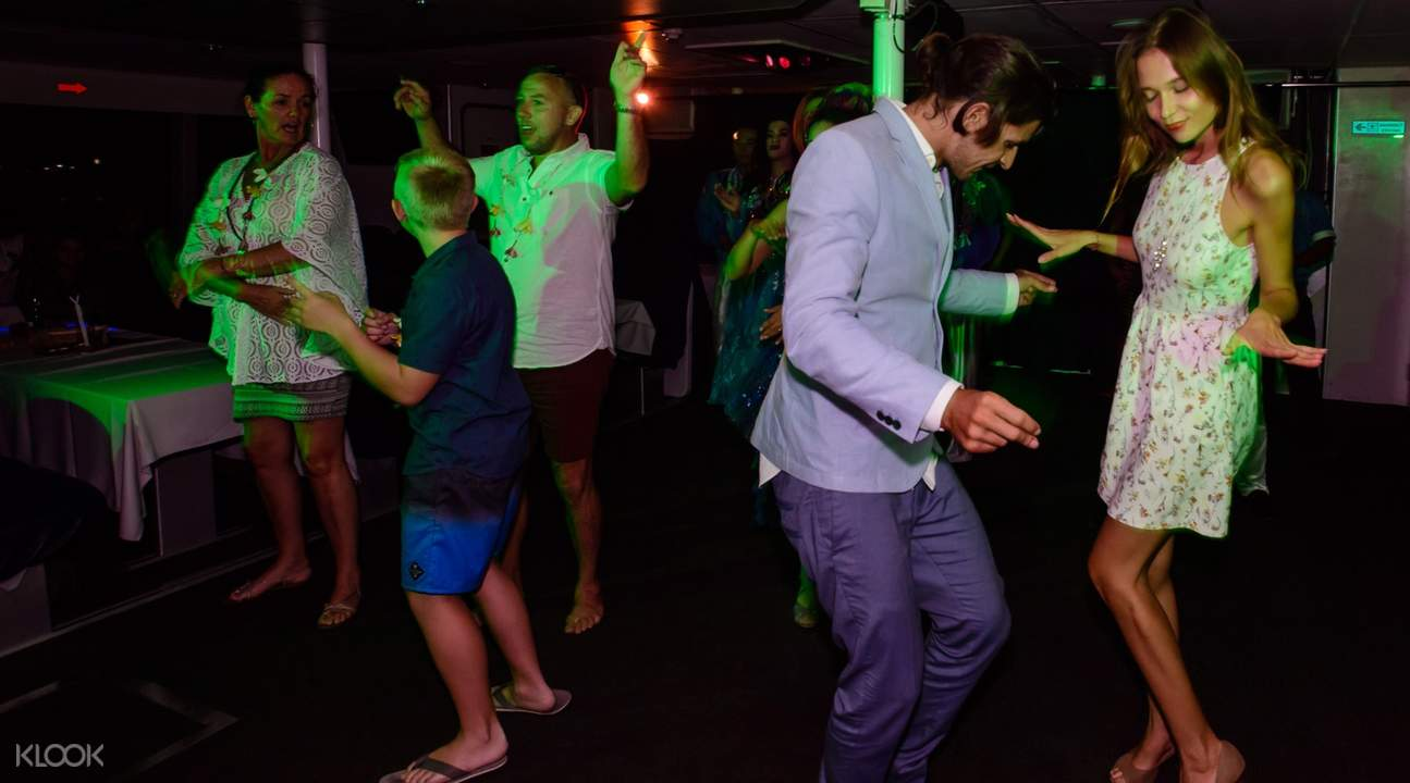 guests dancing on the Bali Hai II cruise