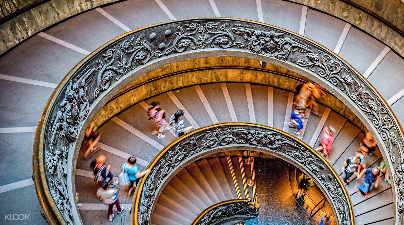 stairs somewhere in the Vatican Museums with people walking up and down