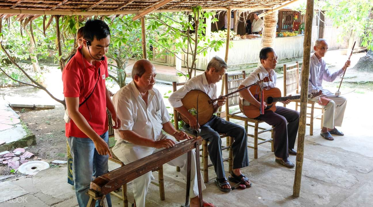 villagers playing Vietnamese instruments