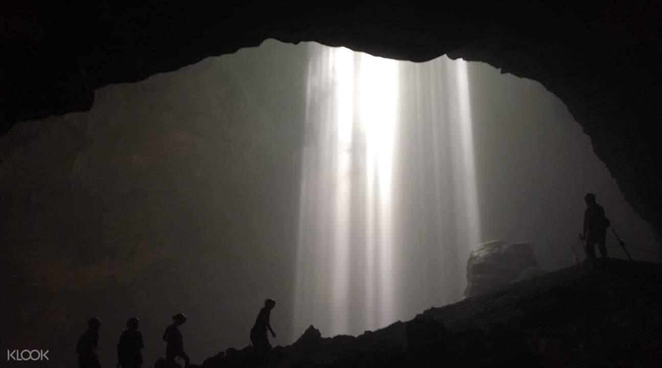 tourists climbing cave
