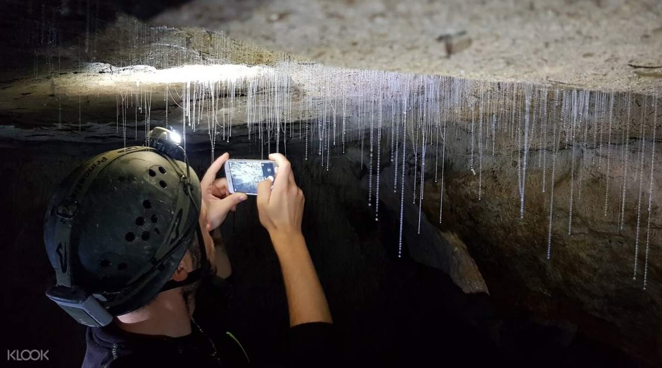 person taking photos inside a cave