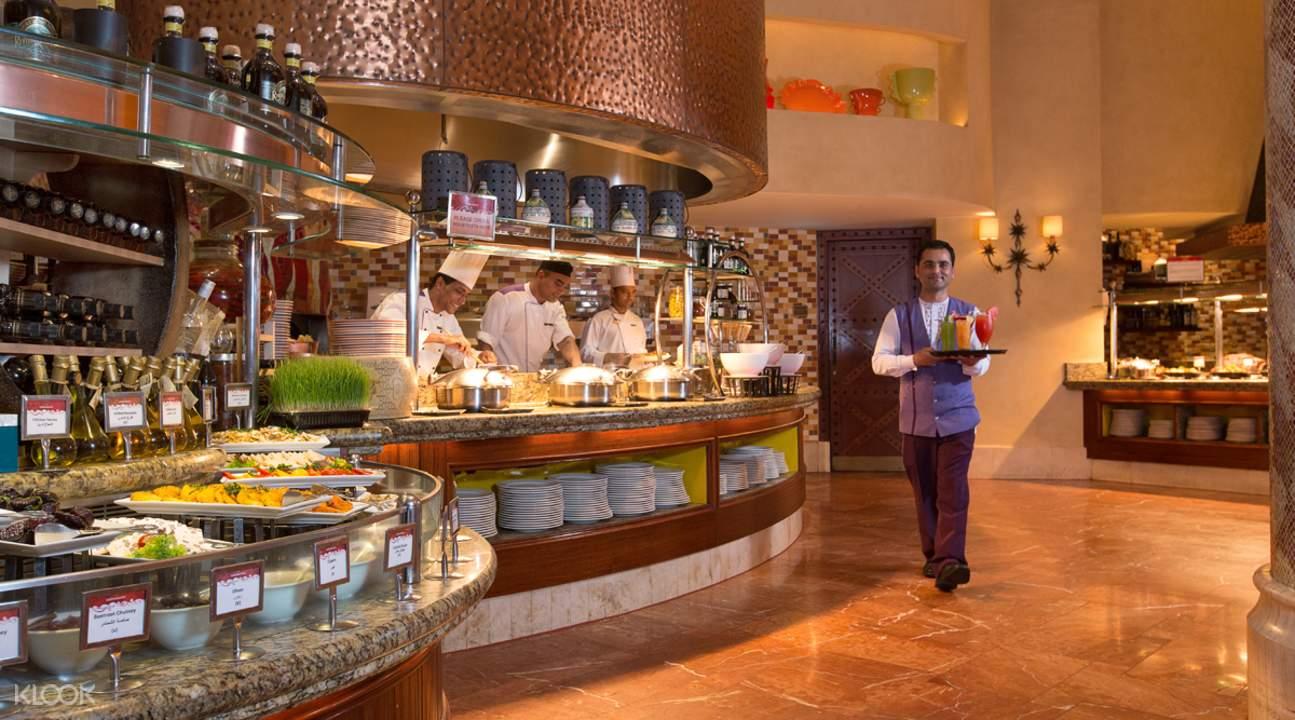 waiter and chefs at the kaleidoscope buffet at atlantis dubai palm island